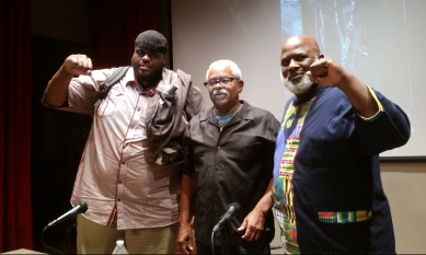 Dr. Modibo Kadalie (center) at the Atlanta Radical Book Fair with Haroun Wakil (left) of the West End Street Groomers and Dr. Akinyele Umoja (right) Professor and Department Chair of the Department of African-American Studies at Georgia State University.